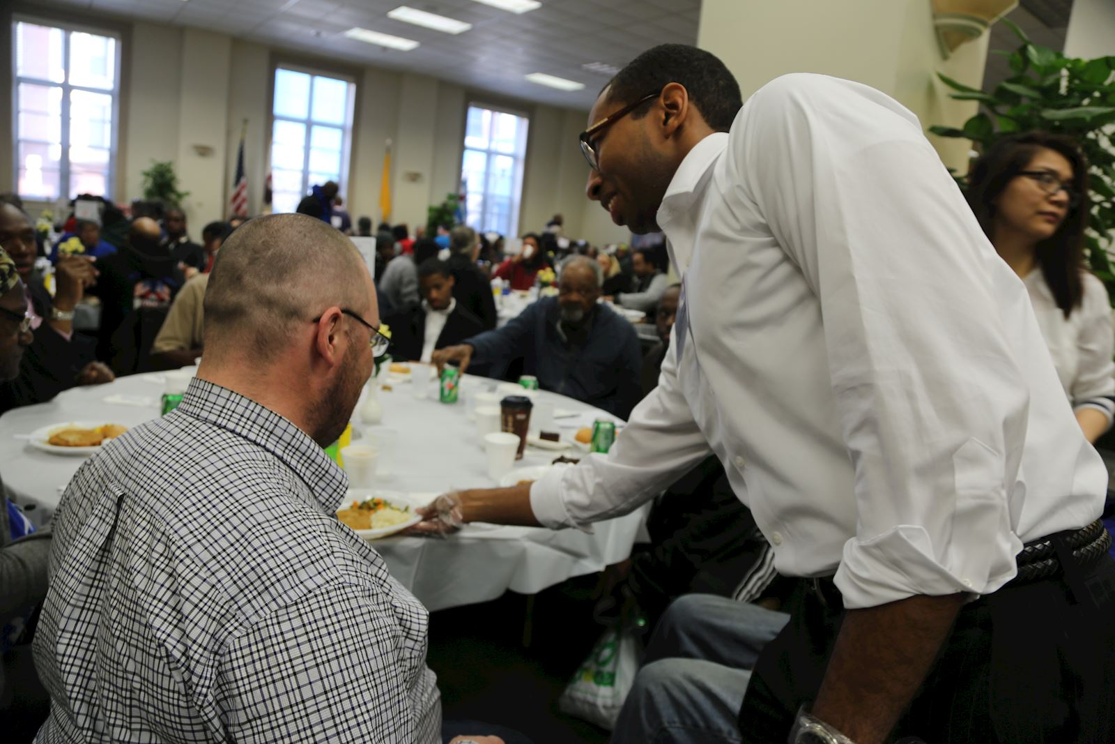 A volunteer serves a meal at one of our daily suppers