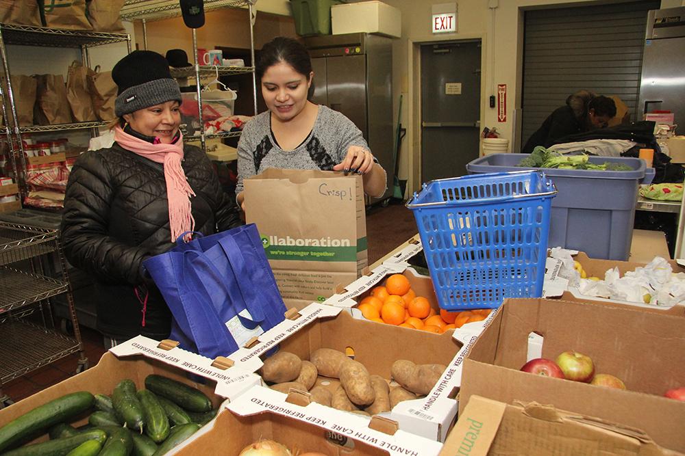 Volunteers working in a food pantry