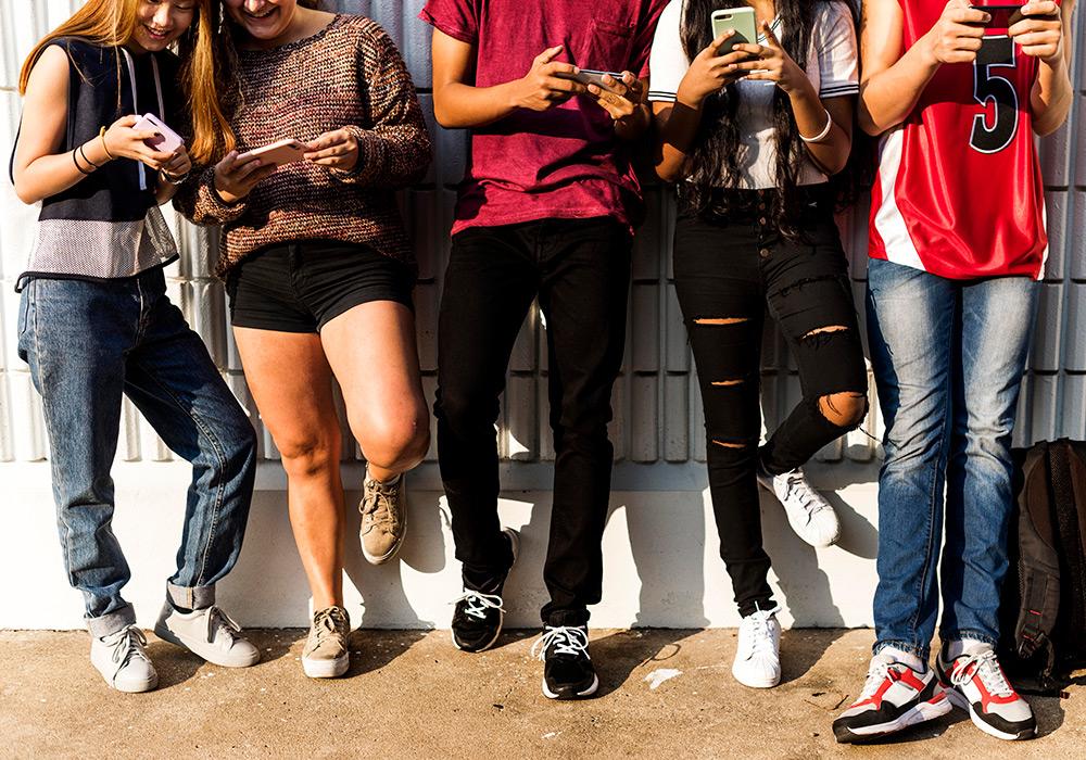 Group of teens on smart phones