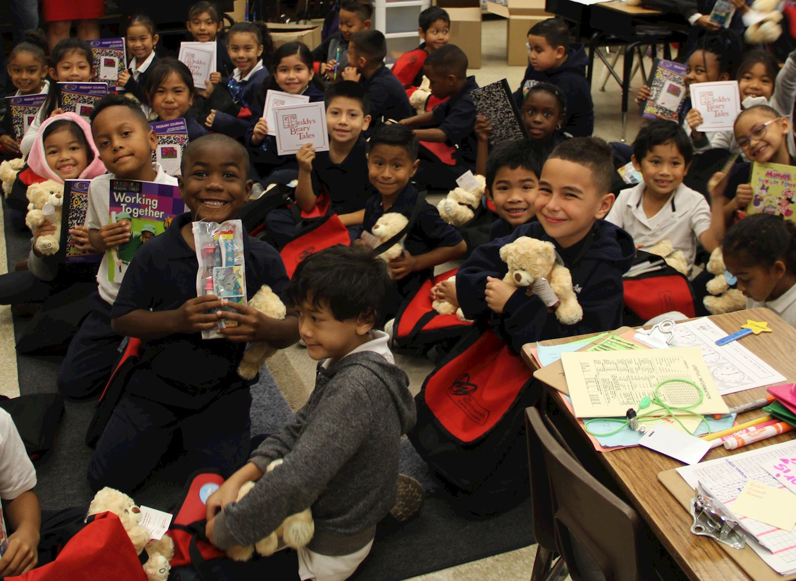 First graders during an Operation Teddy Bear school visit and distribution