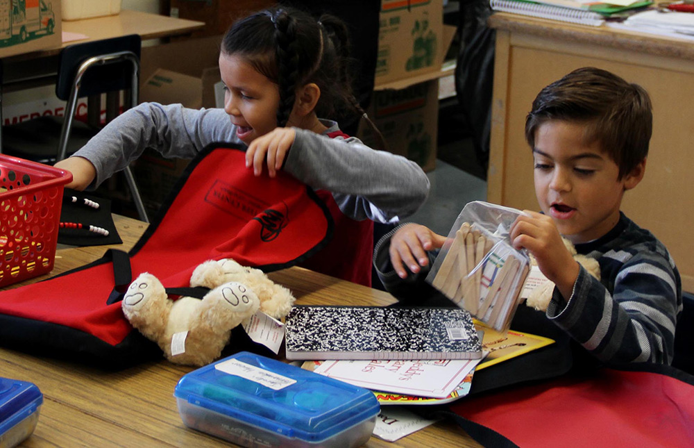 First grade students with Operation Teddy Bear STEAM Kit and Rekenrek