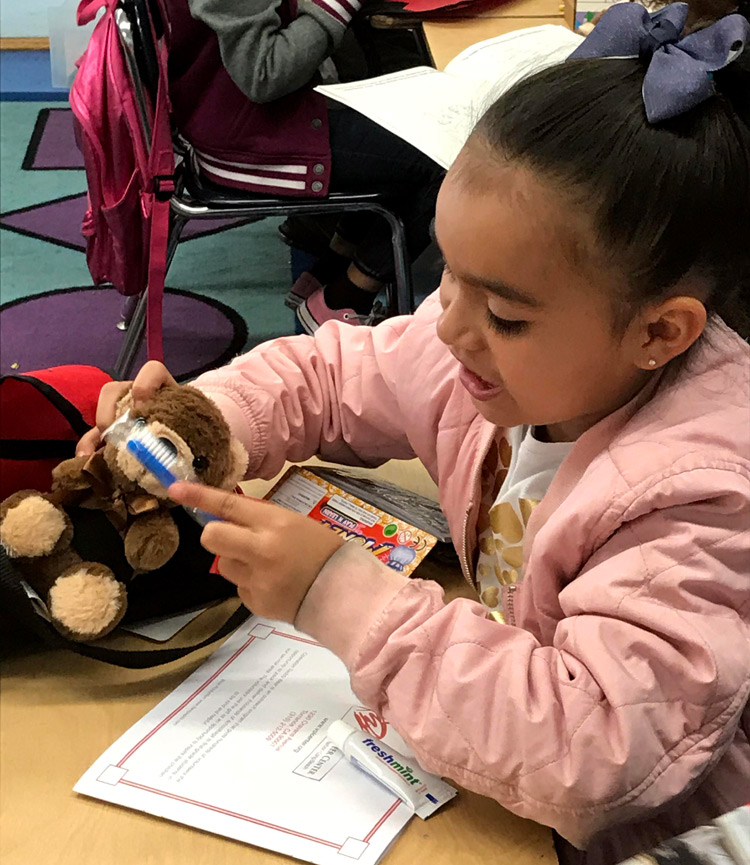 Operation Teddy Bear student with teddy bear