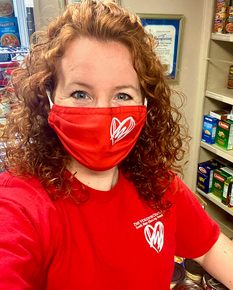 President/CEO Sara Myers wearing a Heart of Helping Superhero Mask